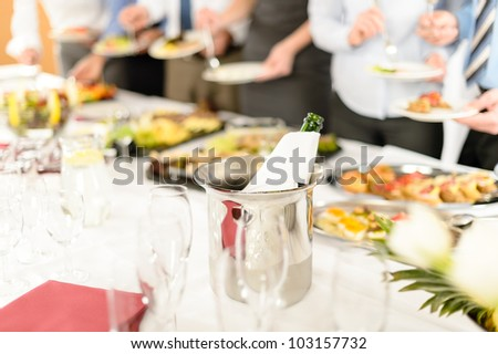 Company celebration close-up of wine bottle in cooling bucket - stock photo