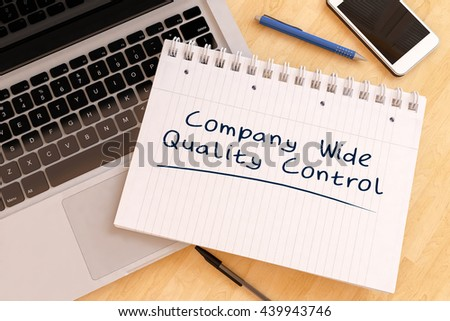 Company Wide Quality Control - handwritten text in a notebook on a desk - 3d render illustration. - stock photo