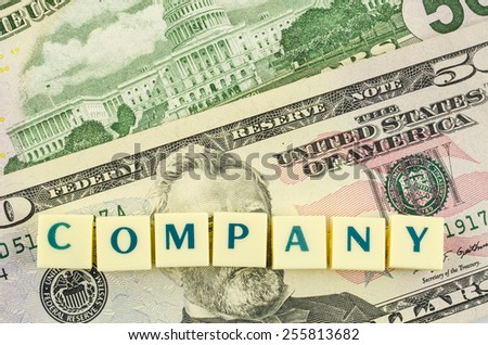 Company word on dollar background. Finance concept