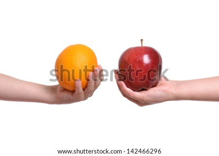 compare apple to orange white background - stock photo