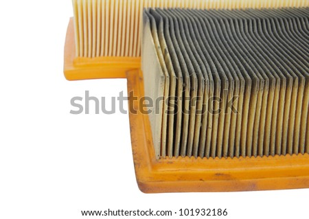 comparing new and old car air filters - stock photo
