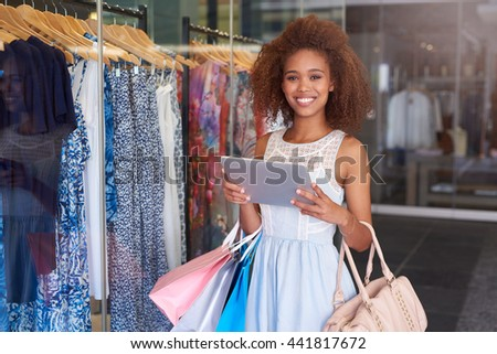 Comparing store and online prices - stock photo