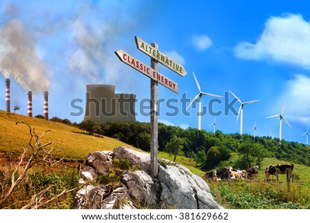 Comparison of plant renewable energy and energy factories classic. Mountain landscape clean and healthy vs dirty and polluted. With wooden sign and title alternative and classic energy - stock photo