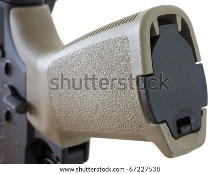 compartment for storage in the pistol grip of an assault rifle - stock photo