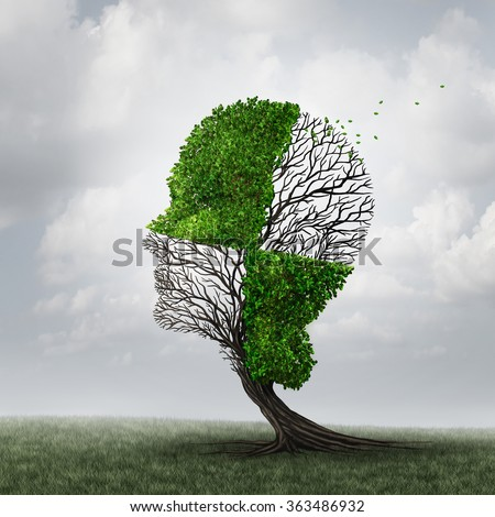 Compartmentalization and neurology compartmentalize psychology as a mind defense mechanism concept or mental health disease metaphor as dementia with a tree shaped as a head with a checkered pattern. - stock photo