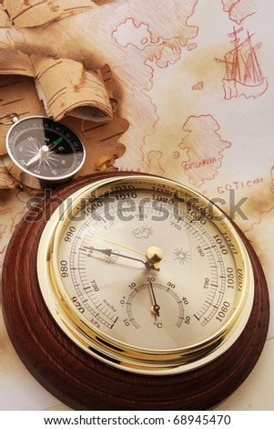 Compass and barometer on old chart of North Europe - stock photo