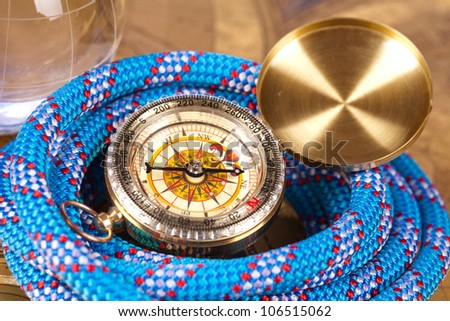 compass and blue marine  rope