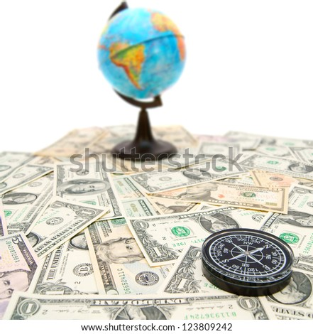 Compass and globe on dollars. On a white background.