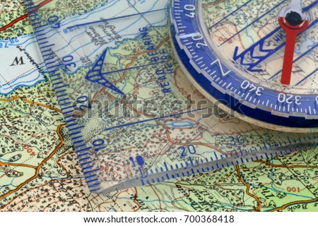 Compass map magnetic compass being lined stock photo 700368418 compass and map a magnetic compass being lined up on map grid lines gumiabroncs Gallery