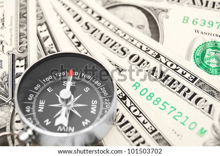 Compass and money. On a white background.