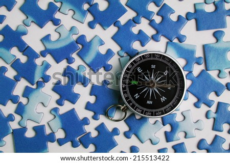 compass and puzzle - stock photo