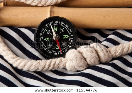 compass and rope - stock photo