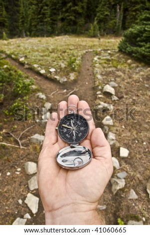 compass and trail fork - stock photo