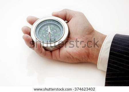 compass in hand on a white background.business concept. - stock photo
