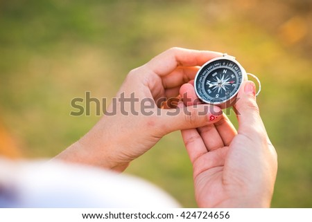 Compass in the hand. conceptual of global travel , tourism and exploration, with copyspace