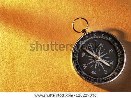 compass indicates the direction of movement and the old paper background - stock photo