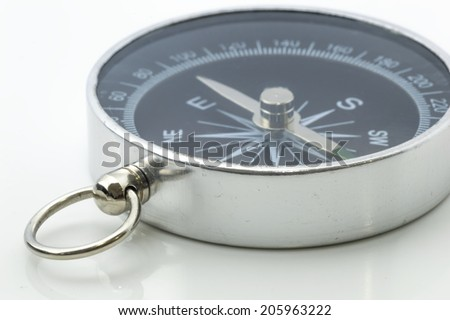 Compass isolated on white with selective focused - stock photo