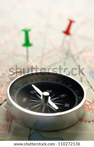 compass, map and pushpin on the table - stock photo