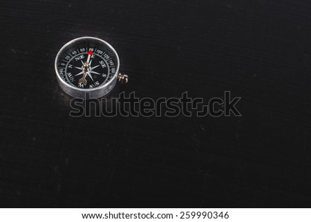 compass on a black background - stock photo