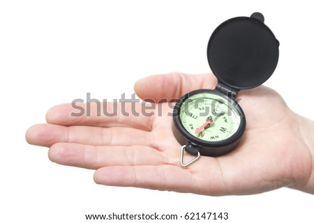 compass on a hand - stock photo