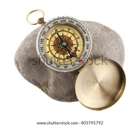 compass on a stone isolated a white background - stock photo