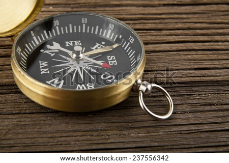 compass on a wooden background - stock photo