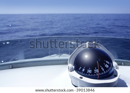 Compass on a yacht boat tower on a blue summer sea ocean day - stock photo