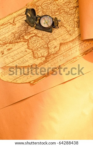 Compass on ancient world map and parchment paper, focus on compass - stock photo