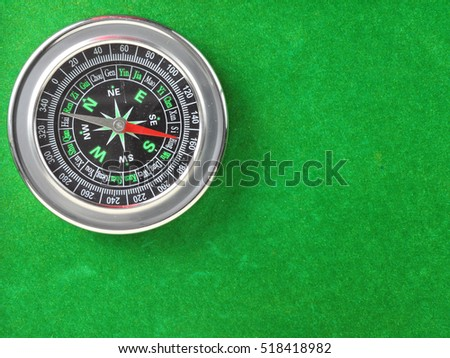 compass on green grass background