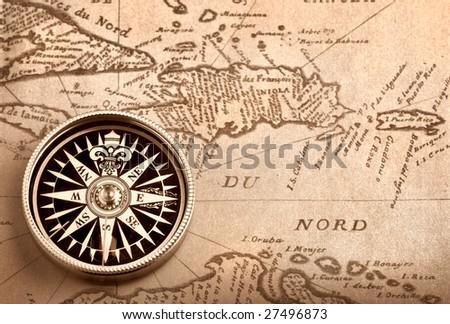 Compass on old handwritten map of Caribbean basin - stock photo