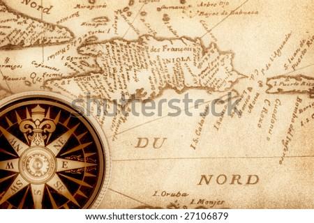 Compass on old handwritten map of Haiti - stock photo