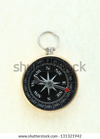 compass on old paper background - stock photo