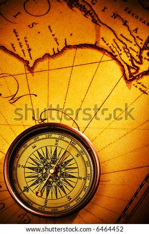 compass on old textured paper with copyspace - stock photo