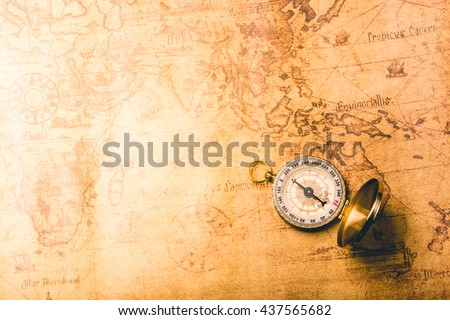 Compass on old vintage map. - stock photo