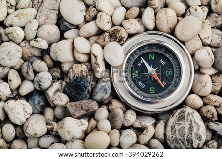 compass on scree background