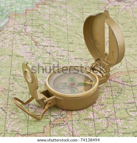 compass on the map - stock photo