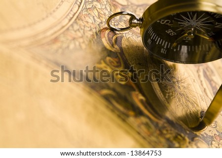 Compass on the old map background - stock photo