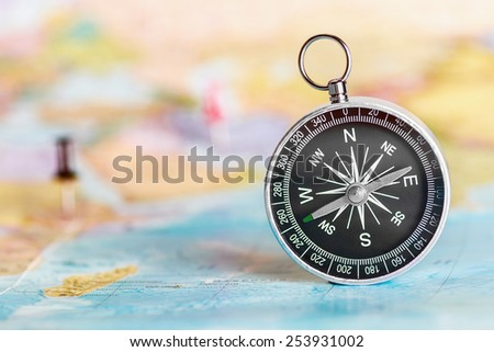 compass on the tourist map. Focus on the compass needle - stock photo