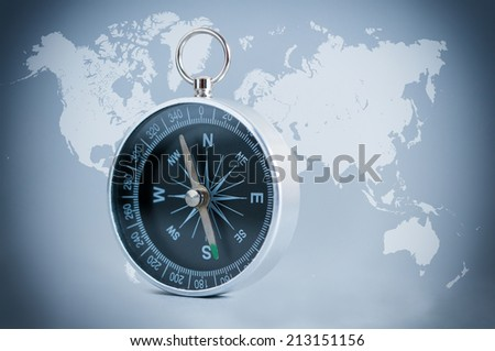 Compass on the world map background. - stock photo