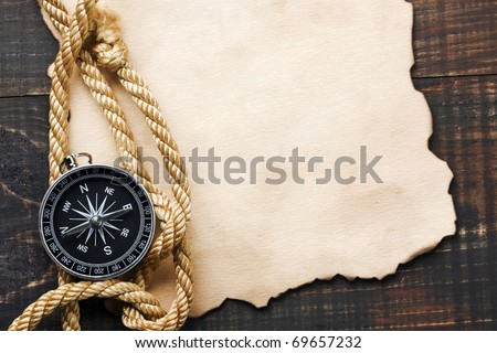 Compass on vintage paper background - stock photo