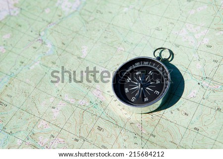 Compass over map background. Top view.