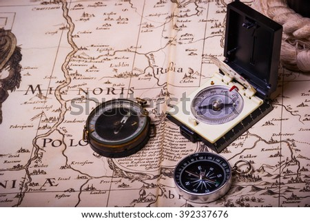Compass, spyglass, rope on the old map.Sail theme. background.