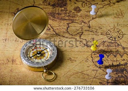 compass with marked location on old map - stock photo