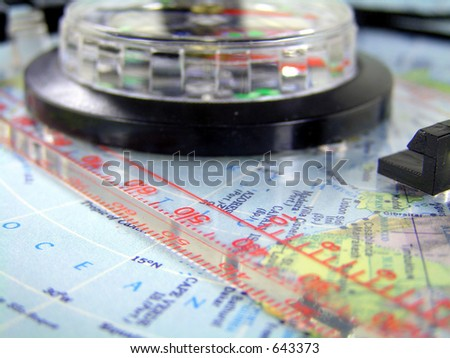 compass  with ruler on a map of the americas. shallow depth of field. - stock photo