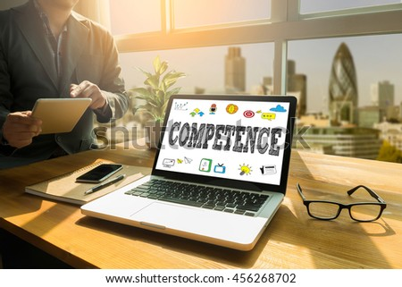 COMPETENCE  ( Skill Ability Proficiency Accomplishment) Thoughtful male person looking to the digital tablet screen, laptop screen,Silhouette and filter sun - stock photo