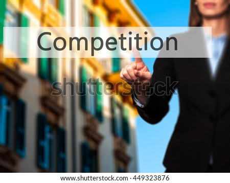 Competition -  Successful businesswoman making use of innovative technologies and finger pressing button. Business, future and technology concept. Stock Photo - stock photo