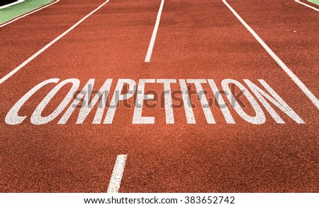 Competition written on running track - stock photo