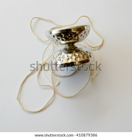 competition yoyo concept in polished aluminum with stainless steel ball bearing and ecru ivory with surface treatments that recall the golf ball - stock photo