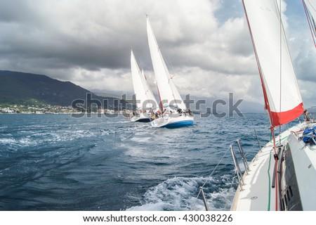 "Competitions sea yachts under sail. Tivat, Montenegro - 26 April, 2016. Regatta ""Russian stream"" in God-Katorskaya bay of the Adriatic Sea off the coast of Montenegro. - stock photo"
