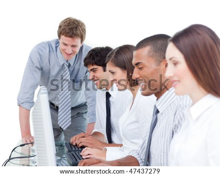 Competitive business team working at a computer in the office